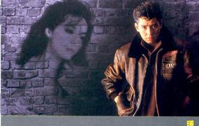 墙上的肖像歌词谐音 谭咏麟粤语歌曲